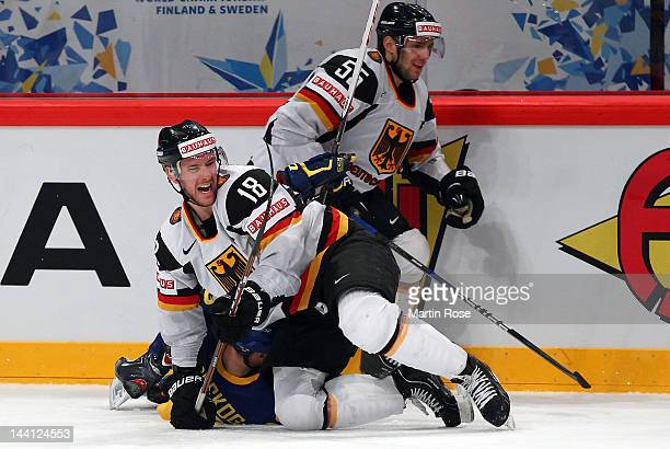 Gabriel Landeskog of Sweden and Kai Hospelt of Germany battle for the puck during the IIHF World Championship group S match between Sweden and...