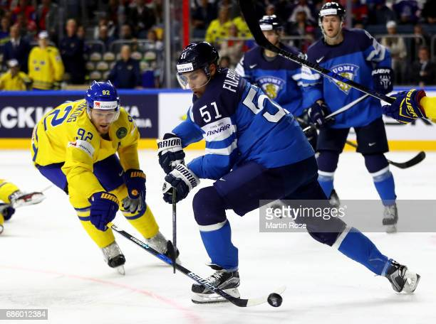 Gabriel Landeskog of Sweden challenges Valtteri Filppula of Finland for the puck during the 2017 IIHF Ice Hockey World Championship semi final game...