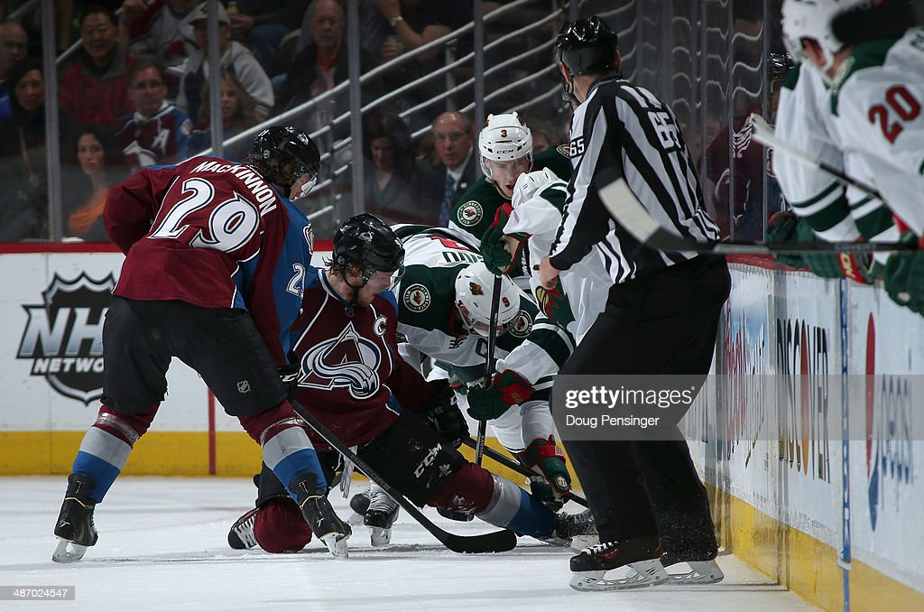 <a gi-track='captionPersonalityLinkClicked' href=/galleries/search?phrase=Gabriel+Landeskog&family=editorial&specificpeople=6590816 ng-click='$event.stopPropagation()'>Gabriel Landeskog</a> #92 of the Colorado Avalanche and <a gi-track='captionPersonalityLinkClicked' href=/galleries/search?phrase=Mikko+Koivu&family=editorial&specificpeople=584987 ng-click='$event.stopPropagation()'>Mikko Koivu</a> #9 of the Minnesota Wild battle for control of the puck as <a gi-track='captionPersonalityLinkClicked' href=/galleries/search?phrase=Nathan+MacKinnon&family=editorial&specificpeople=8610127 ng-click='$event.stopPropagation()'>Nathan MacKinnon</a> #29 of the Colorado Avalanche, <a gi-track='captionPersonalityLinkClicked' href=/galleries/search?phrase=Charlie+Coyle&family=editorial&specificpeople=7029381 ng-click='$event.stopPropagation()'>Charlie Coyle</a> #3 of the Minnesota Wild and linesman <a gi-track='captionPersonalityLinkClicked' href=/galleries/search?phrase=Pierre+Racicot&family=editorial&specificpeople=2129971 ng-click='$event.stopPropagation()'>Pierre Racicot</a> #65 follow the play in Game Five of the First Round of the 2014 NHL Stanley Cup Playoffs at Pepsi Center on April 26, 2014 in Denver, Colorado. The Avalanche defeated the Wild 4-3 in overtime to take a 3-2 game lead in the series.