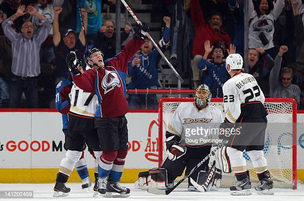 Gabriel Landeskog of the Colorado Avalanche celebrates his game winning goal in overtime against goalie Jonas Hiller of the Anaheim Ducks as the...