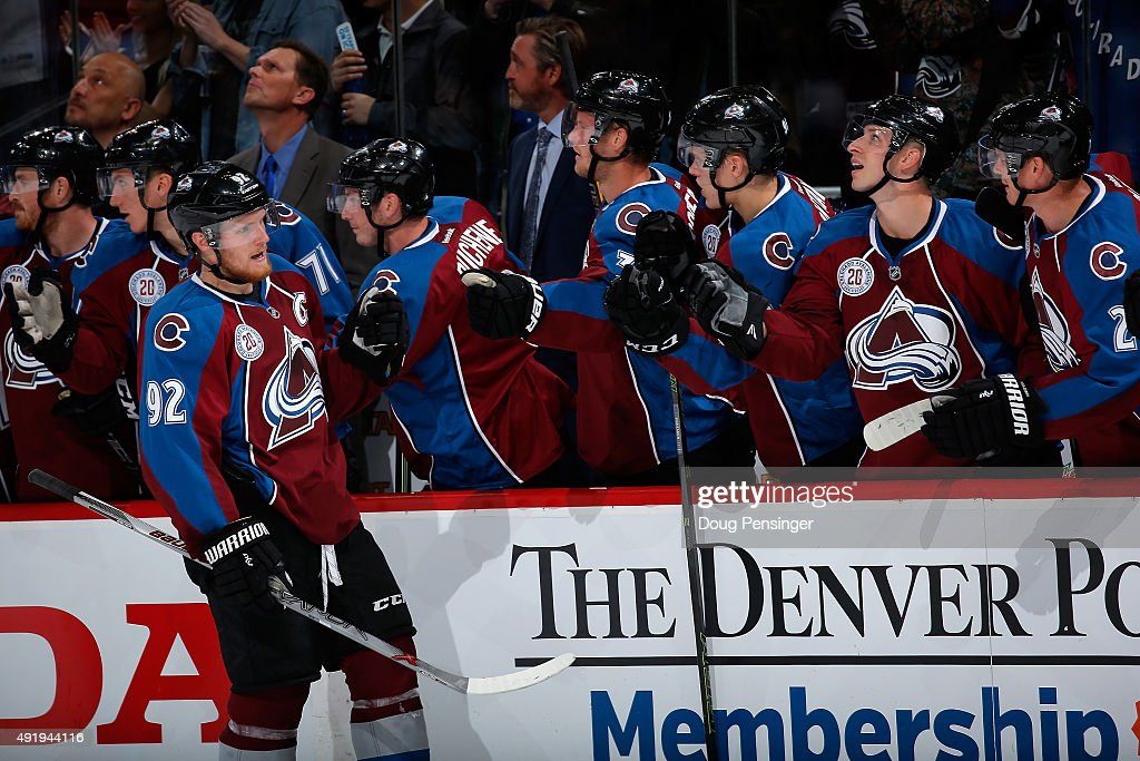 Gabriel Landeskog #92 of the Colorado Avalanche celebrates his goal against goalie Devan Dubnyk #40 of the Minnesota Wild with his teammates to give the Avs a 3-0 lead in the first periodat Pepsi Center on October 8, 2015 in Denver, Colorado.