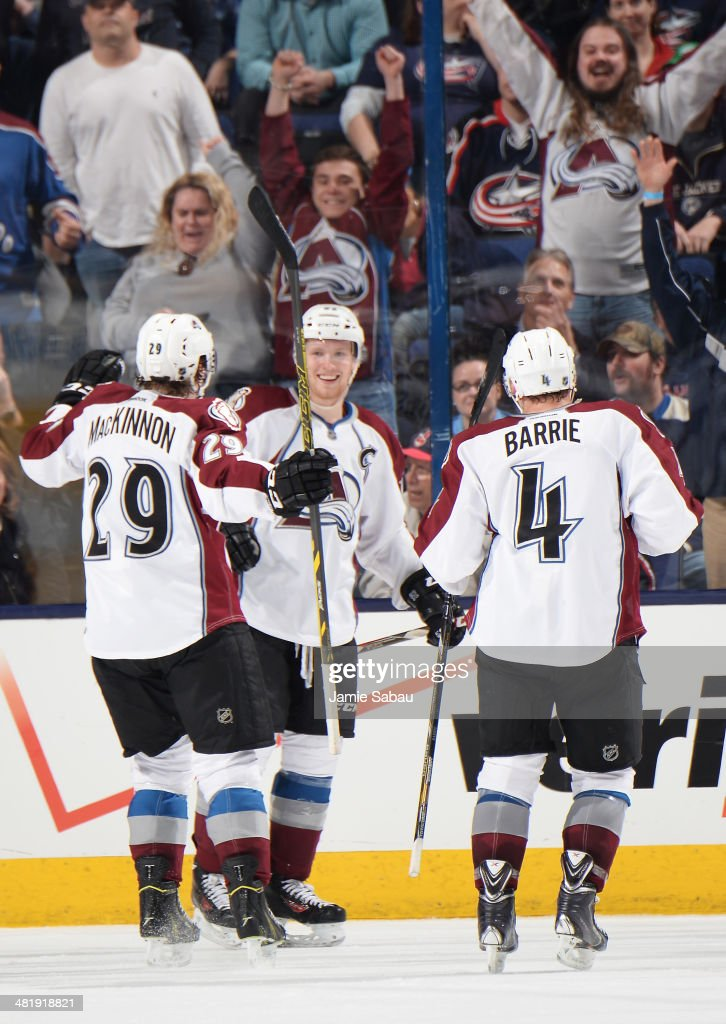 <a gi-track='captionPersonalityLinkClicked' href=/galleries/search?phrase=Gabriel+Landeskog&family=editorial&specificpeople=6590816 ng-click='$event.stopPropagation()'>Gabriel Landeskog</a> #92 of the Colorado Avalanche celebrates his game-winning overtime goal with teammates <a gi-track='captionPersonalityLinkClicked' href=/galleries/search?phrase=Nathan+MacKinnon&family=editorial&specificpeople=8610127 ng-click='$event.stopPropagation()'>Nathan MacKinnon</a> #29 and <a gi-track='captionPersonalityLinkClicked' href=/galleries/search?phrase=Tyson+Barrie&family=editorial&specificpeople=4669265 ng-click='$event.stopPropagation()'>Tyson Barrie</a> #4 on April 1, 2014 at Nationwide Arena in Columbus, Ohio. Colorado defeated Columbus 3-2 in overtime.