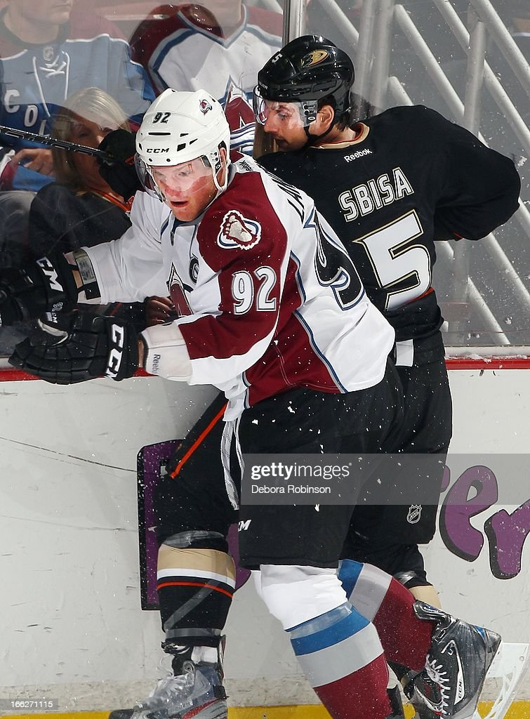 Gabriel Landeskog #92 of the Colorado Avalanche checks Luca Sbisa #5 of the Anaheim Ducks up against the glass April 10, 2013 at Honda Center in Anaheim, California.