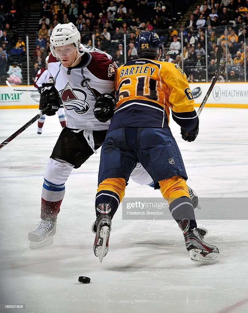 Gabriel Landeskog #92 of the Colorado Avalanche collides with Victor Bartley #64 of the Nashville Predators at the Bridgestone Arena on April 2, 2013 in Nashville, Tennessee.