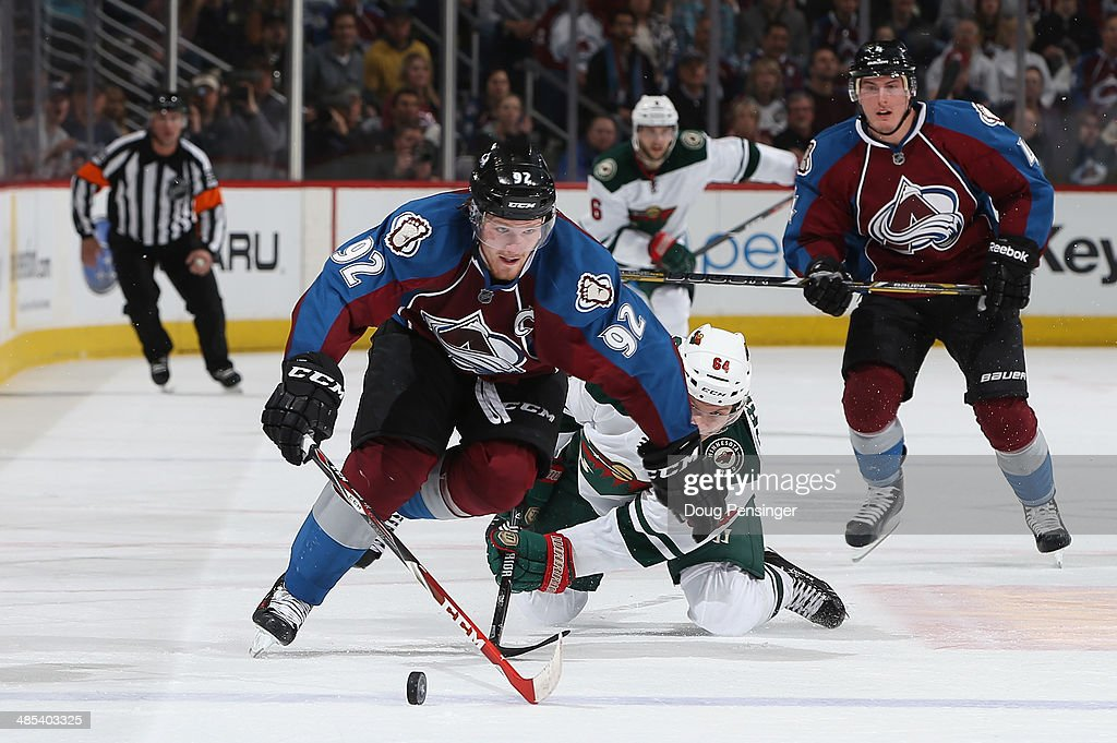 <a gi-track='captionPersonalityLinkClicked' href=/galleries/search?phrase=Gabriel+Landeskog&family=editorial&specificpeople=6590816 ng-click='$event.stopPropagation()'>Gabriel Landeskog</a> #92 of the Colorado Avalanche controls the puck against <a gi-track='captionPersonalityLinkClicked' href=/galleries/search?phrase=Mikael+Granlund&family=editorial&specificpeople=5649678 ng-click='$event.stopPropagation()'>Mikael Granlund</a> #64 of the Minnesota Wild in Game One of the First Round of the 2014 NHL Stanley Cup Playoffs at Pepsi Center on April 17, 2014 in Denver, Colorado.