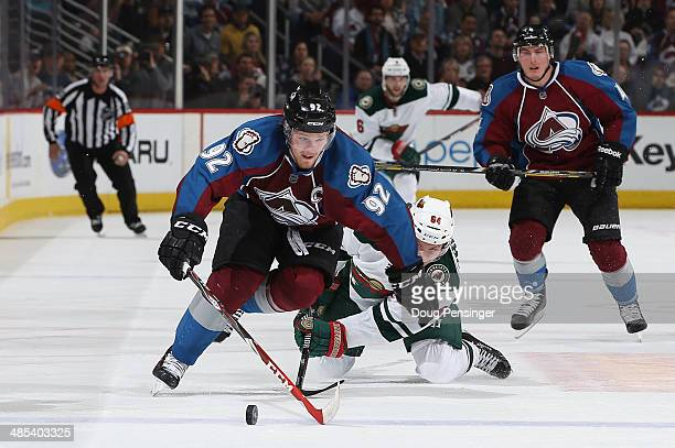 Gabriel Landeskog of the Colorado Avalanche controls the puck against Mikael Granlund of the Minnesota Wild in Game One of the First Round of the...