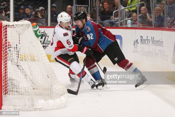 Gabriel Landeskog of the Colorado Avalanche fights for position against Chris Wideman of the Ottawa Senators at the Pepsi Center on March 11 2017 in...