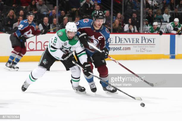 Gabriel Landeskog of the Colorado Avalanche fights position against Dan Hamhuis of the Dallas Stars at the Pepsi Center on November 22 2017 in Denver...