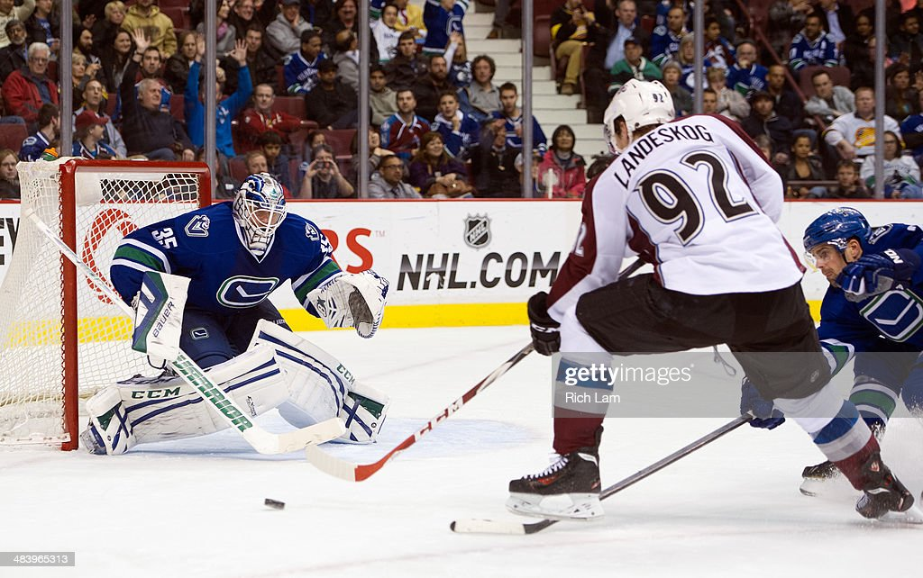 <a gi-track='captionPersonalityLinkClicked' href=/galleries/search?phrase=Gabriel+Landeskog&family=editorial&specificpeople=6590816 ng-click='$event.stopPropagation()'>Gabriel Landeskog</a> #92 of the Colorado Avalanche fires a shot on goalie <a gi-track='captionPersonalityLinkClicked' href=/galleries/search?phrase=Jacob+Markstrom&family=editorial&specificpeople=5370948 ng-click='$event.stopPropagation()'>Jacob Markstrom</a> #35 of the Vancouver Canucks during the third period in NHL action on April 10, 2014 at Rogers Arena in Vancouver, British Columbia, Canada. <a gi-track='captionPersonalityLinkClicked' href=/galleries/search?phrase=Dan+Hamhuis&family=editorial&specificpeople=204213 ng-click='$event.stopPropagation()'>Dan Hamhuis</a> #2 of the Vancouver Canucks tries to help defend on the play.