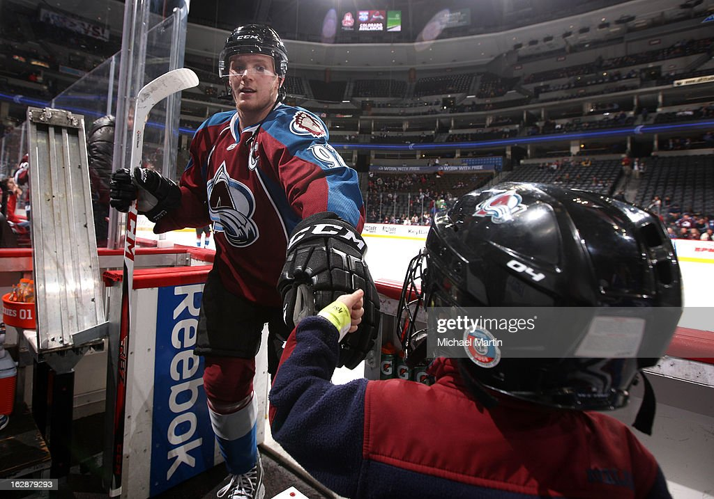 Gabriel Landeskog #92 of the Colorado Avalanche fist bumps a fan during warm ups against the Calgary Flames at the Pepsi Center on February 28, 2013 in Denver, Colorado.