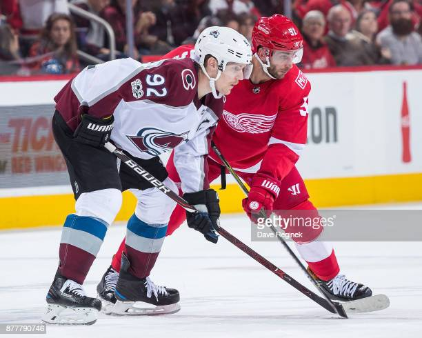 Gabriel Landeskog of the Colorado Avalanche gets set for the faceoff next to Frans Nielsen of the Detroit Red Wings during an NHL game at Little...