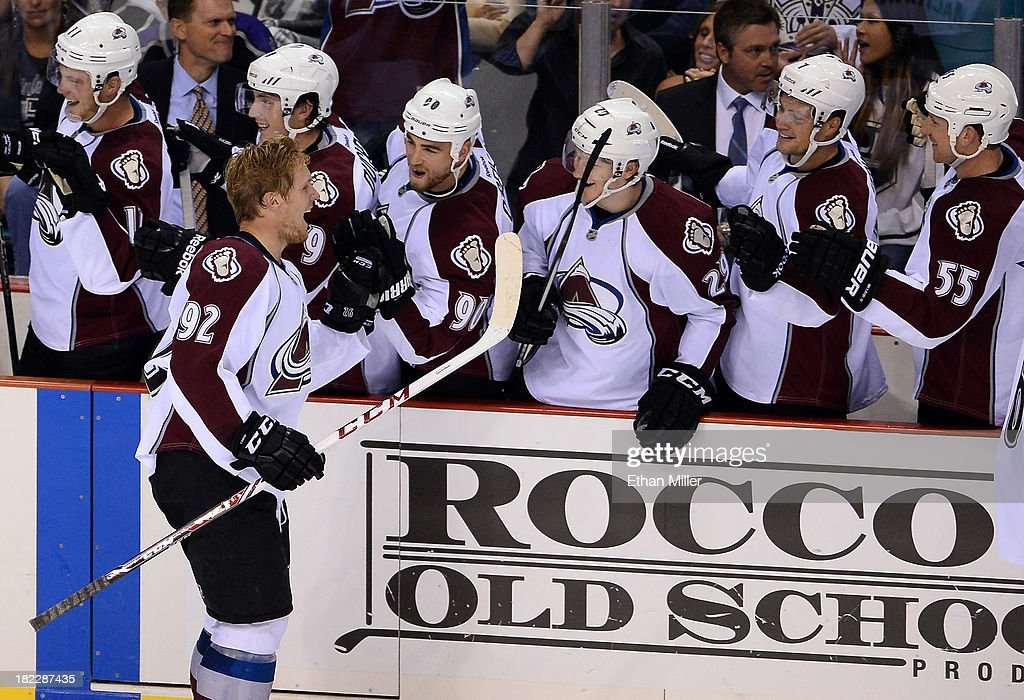 <a gi-track='captionPersonalityLinkClicked' href=/galleries/search?phrase=Gabriel+Landeskog&family=editorial&specificpeople=6590816 ng-click='$event.stopPropagation()'>Gabriel Landeskog</a> #92 of the Colorado Avalanche is congratulated by teammates on the bench after scoring a goal against the Los Angles Kings during their preseason game at the MGM Grand Garden Arena on September 28, 2013 in Las Vegas, Nevada. Colorado won 3-2.
