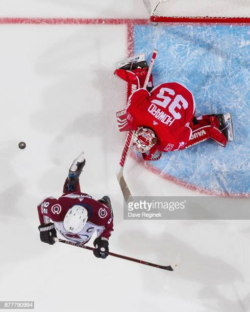 Gabriel Landeskog of the Colorado Avalanche jumps out of the way of a shot on Jimmy Howard of the Detroit Red Wings during an NHL game at Little...