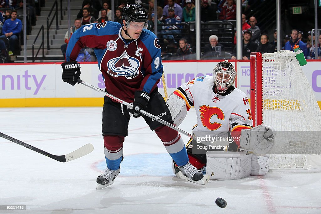 Gabriel Landeskog #92 of the Colorado Avalanche looks to control the puck as goalie Karri Ramo #31 of the Calgary Flames defends the goal at Pepsi Center on November 3, 2015 in Denver, Colorado. The Avalanche defeated the Flames 6-3.