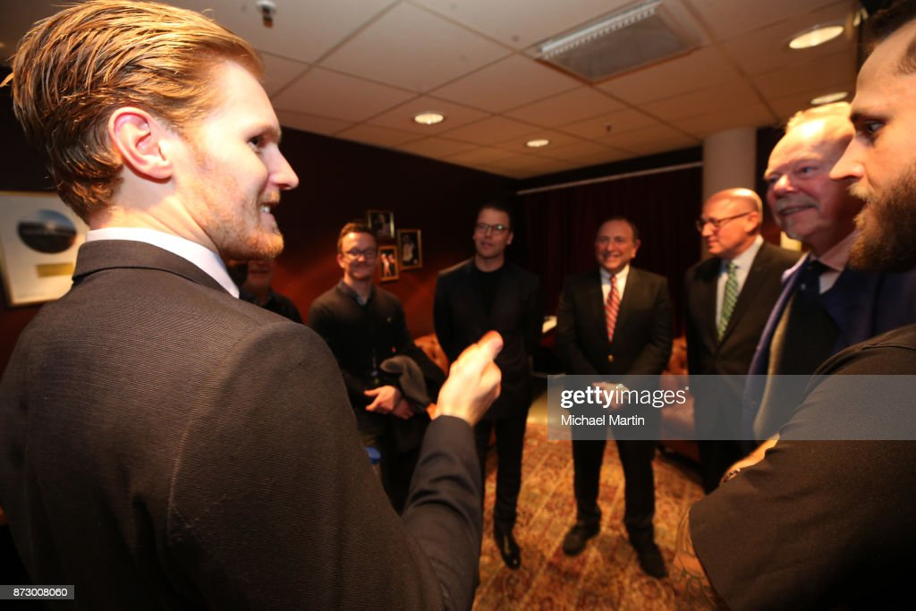 Gabriel Landeskog #92 of the Colorado Avalanche meets with Prince Daniel, Duke of Vastergotland, along with Gary Bettman, Bill Daly, Thomas Johansson and Fredrik Claesson #33 of the Ottawa Senators after the game at the Ericsson Globe on November 11, 2017 in Stockholm, Sweden.