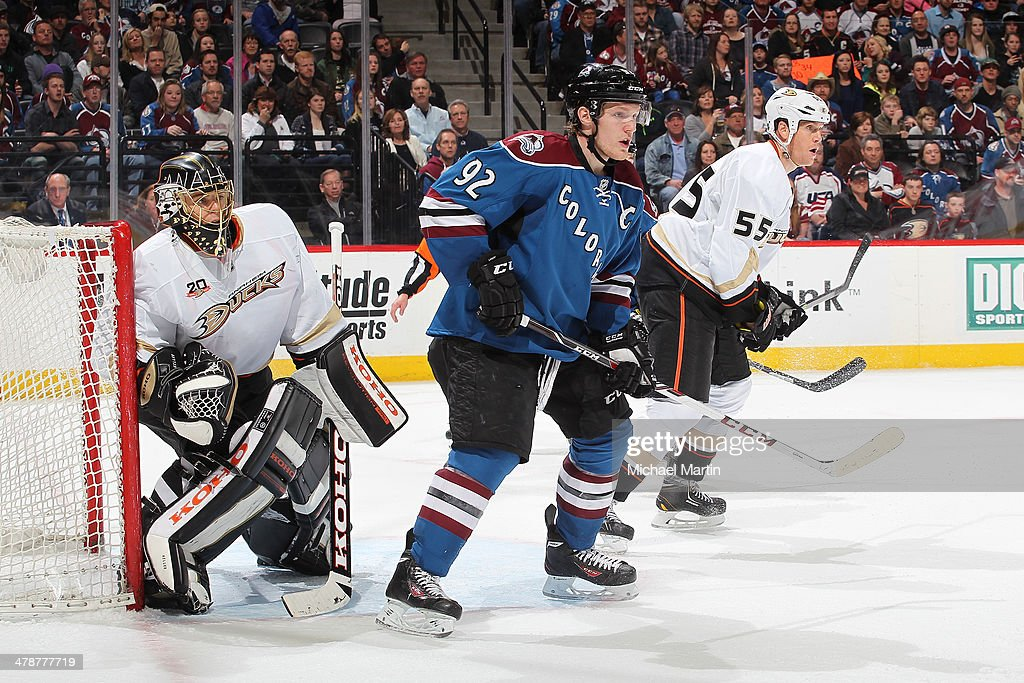 Gabriel Landeskog #92 of the Colorado Avalanche positions himself in front of the goal while goaltender Jonas Hiller #1 and Bryan Allen #55 of the Anaheim Ducks defend at the Pepsi Center on March 14, 2014 in Denver, Colorado. The Ducks defeated the Avalanche 6-4.
