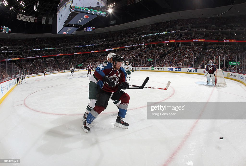 <a gi-track='captionPersonalityLinkClicked' href=/galleries/search?phrase=Gabriel+Landeskog&family=editorial&specificpeople=6590816 ng-click='$event.stopPropagation()'>Gabriel Landeskog</a> #92 of the Colorado Avalanche pursues the puck against the Minnesota Wild in Game One of the First Round of the 2014 NHL Stanley Cup Playoffs at Pepsi Center on April 17, 2014 in Denver, Colorado. The Avalanche defeated the Wild 5-4 in overtime to take a 1-0 game advantage in the series.