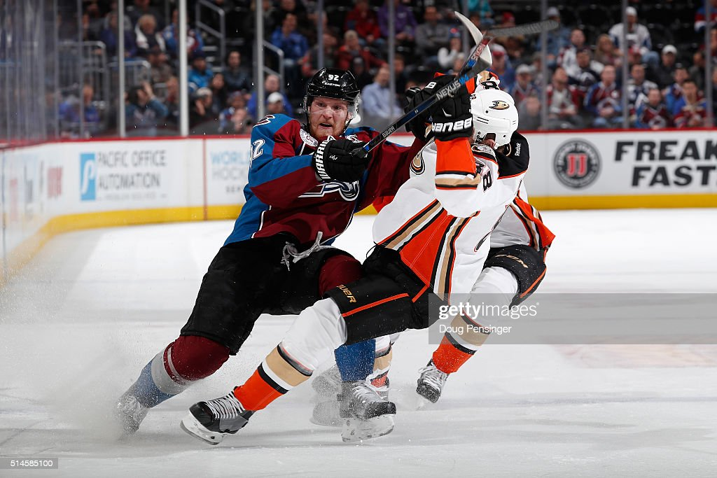 <a gi-track='captionPersonalityLinkClicked' href=/galleries/search?phrase=Gabriel+Landeskog&family=editorial&specificpeople=6590816 ng-click='$event.stopPropagation()'>Gabriel Landeskog</a> #92 of the Colorado Avalanche puts a hit on <a gi-track='captionPersonalityLinkClicked' href=/galleries/search?phrase=Jamie+McGinn&family=editorial&specificpeople=537964 ng-click='$event.stopPropagation()'>Jamie McGinn</a> #88 of the Anaheim Ducks at Pepsi Center on March 9, 2016 in Denver, Colorado.