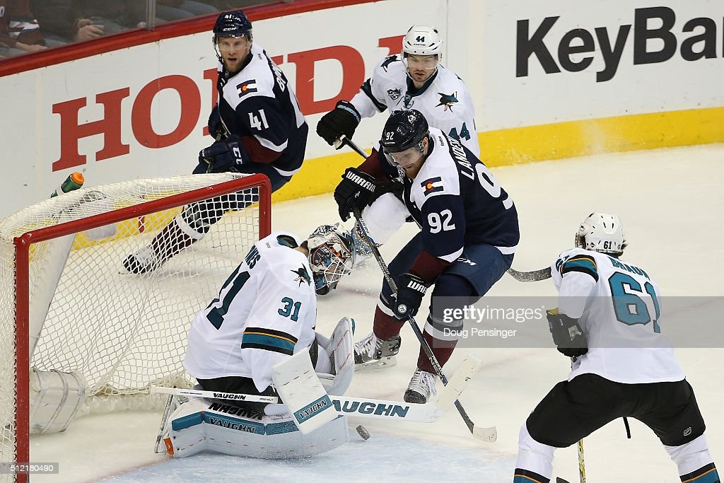 <a gi-track='captionPersonalityLinkClicked' href=/galleries/search?phrase=Gabriel+Landeskog&family=editorial&specificpeople=6590816 ng-click='$event.stopPropagation()'>Gabriel Landeskog</a> #92 of the Colorado Avalanche puts the puck past goalie <a gi-track='captionPersonalityLinkClicked' href=/galleries/search?phrase=Martin+Jones+-+Ice+Hockey+Player&family=editorial&specificpeople=12318960 ng-click='$event.stopPropagation()'>Martin Jones</a> #31 of the San Jose Sharks for a goal to take a 3-2 lead in the third period at Pepsi Center on February 24, 2016 in Denver, Colorado. The Avalanche defeated the Sharks 4-3 in an overtime shoot out.