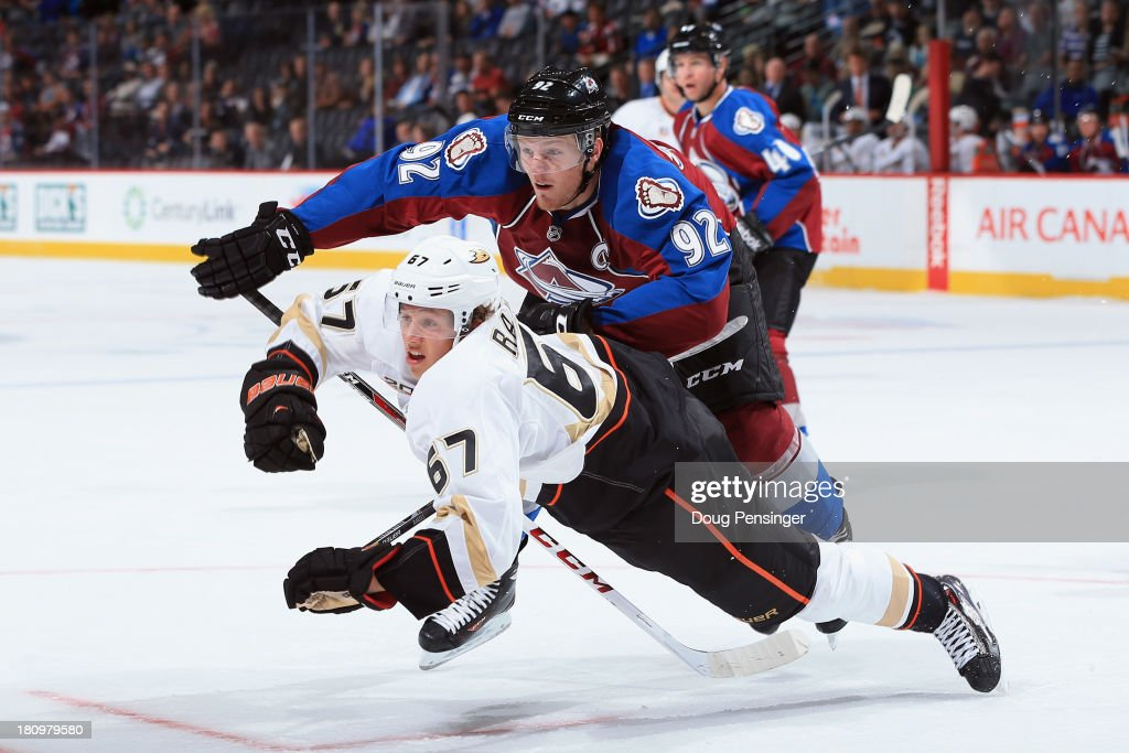 <a gi-track='captionPersonalityLinkClicked' href=/galleries/search?phrase=Gabriel+Landeskog&family=editorial&specificpeople=6590816 ng-click='$event.stopPropagation()'>Gabriel Landeskog</a> #92 of the Colorado Avalanche received a penalty for tripping with this hit on Rickard Rakell #67 of the Anaheim Ducks in the first period during preseason action at Pepsi Center on September 18, 2013 in Denver, Colorado.