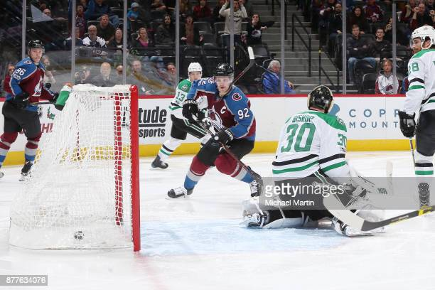 Gabriel Landeskog of the Colorado Avalanche scores a goal against goaltender Ben Bishop of the Dallas Stars at the Pepsi Center on November 22 2017...