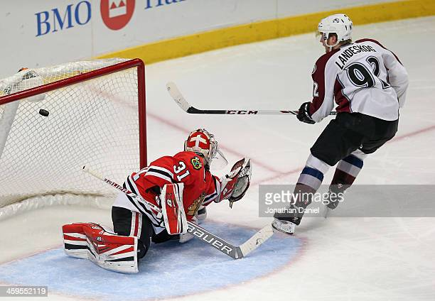 Gabriel Landeskog of the Colorado Avalanche scores a goal in the third period over Antti Raanta of the Chicago Blackhawks at the United Center on...