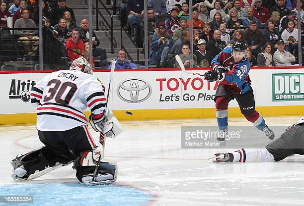 Gabriel Landeskog of the Colorado Avalanche shoots against goaltender Ray Emery of the Chicago Blackhawks at the Pepsi Center on March 8 2013 in...