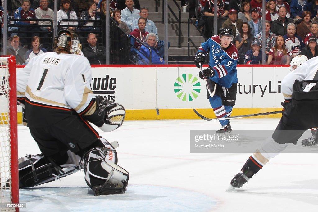 Gabriel Landeskog #92 of the Colorado Avalanche shoots on goaltender Jonas Hiller #1 of the Anaheim Ducks at the Pepsi Center on March 14, 2014 in Denver, Colorado.