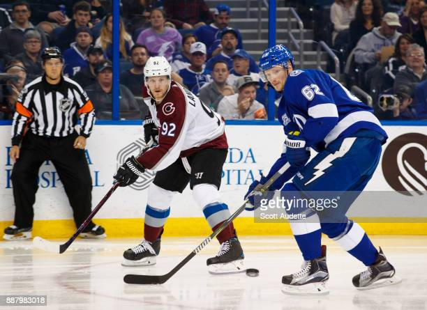 Gabriel Landeskog of the Colorado Avalanche skates against Andrej Sustr of the Tampa Bay Lightning during the second period at Amalie Arena on...