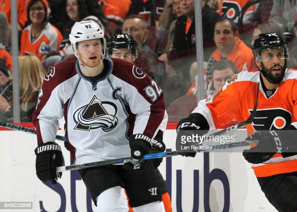 Gabriel Landeskog of the Colorado Avalanche skates against PierreEdouard Bellemare of the Philadelphia Flyers on February 28 2017 at the Wells Fargo...