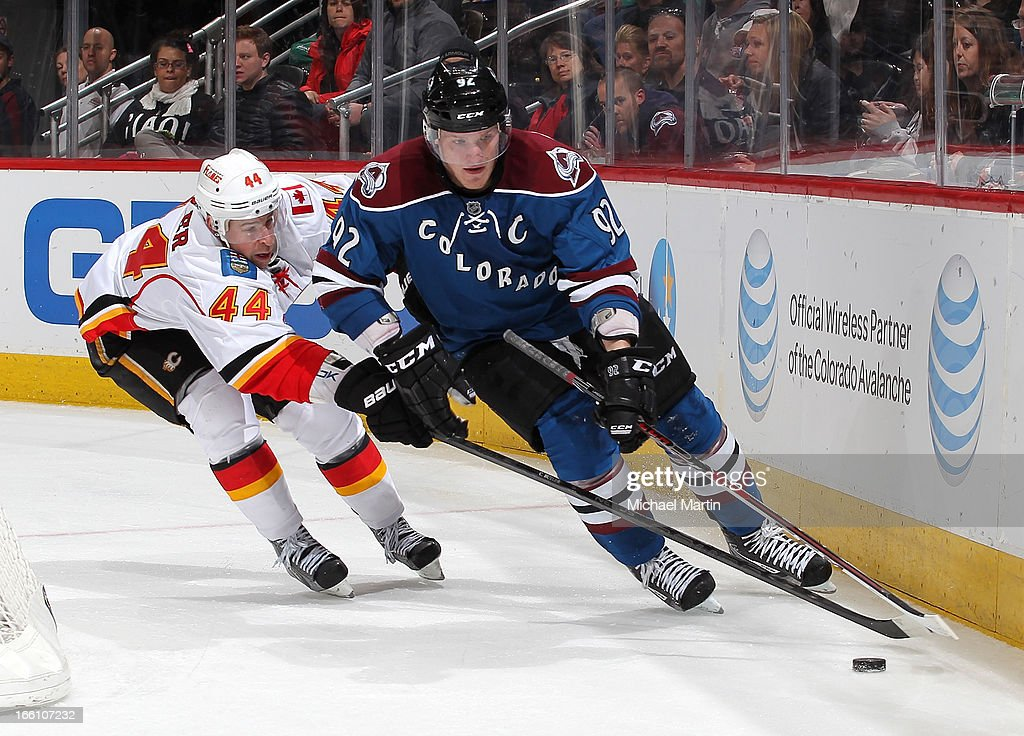 <a gi-track='captionPersonalityLinkClicked' href=/galleries/search?phrase=Gabriel+Landeskog&family=editorial&specificpeople=6590816 ng-click='$event.stopPropagation()'>Gabriel Landeskog</a> #92 of the Colorado Avalanche skates the puck against Chris Butler #44 of the Calgary Flames at the Pepsi Center on April 8, 2013 in Denver, Colorado. Calgary beat Colorado 3-1.