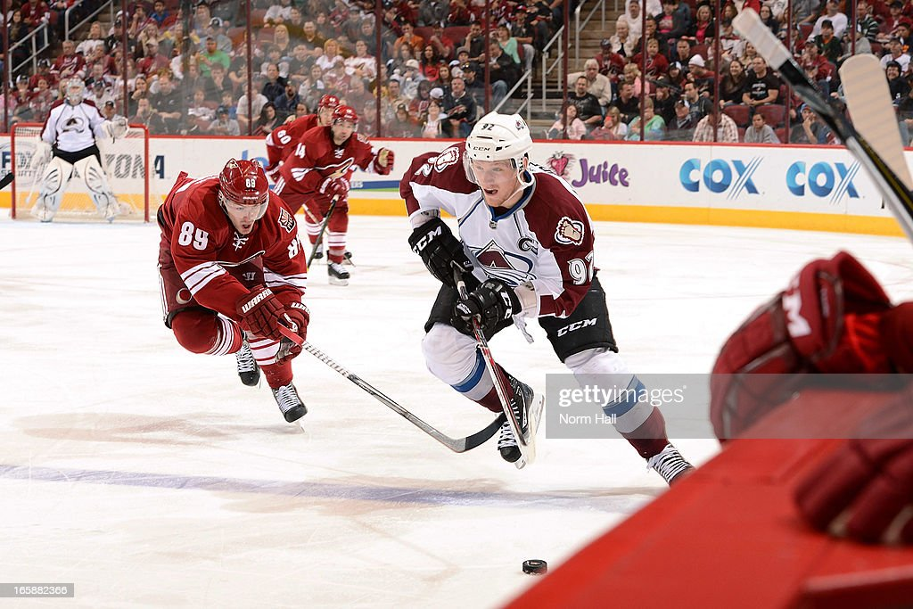 <a gi-track='captionPersonalityLinkClicked' href=/galleries/search?phrase=Gabriel+Landeskog&family=editorial&specificpeople=6590816 ng-click='$event.stopPropagation()'>Gabriel Landeskog</a> #92 of the Colorado Avalanche skates the puck up ice past <a gi-track='captionPersonalityLinkClicked' href=/galleries/search?phrase=Mikkel+Boedker&family=editorial&specificpeople=4697252 ng-click='$event.stopPropagation()'>Mikkel Boedker</a> #89 of the Phoenix Coyotes during the second period at Jobing.com Arena on April 6, 2013 in Glendale, Arizona.