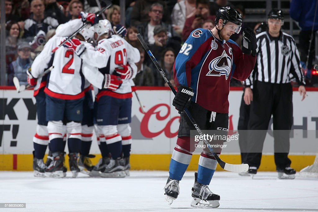 <a gi-track='captionPersonalityLinkClicked' href=/galleries/search?phrase=Gabriel+Landeskog&family=editorial&specificpeople=6590816 ng-click='$event.stopPropagation()'>Gabriel Landeskog</a> #92 of the Colorado Avalanche skates to the bench as the Washington Capitals celebrate a goal by Alex Ovechkin #8 of the Washington Capitals to take a 2-0 lead in the second period at Pepsi Center on April 1, 2016 in Denver, Colorado. The Capitals defeated the Avalanche 4-2.