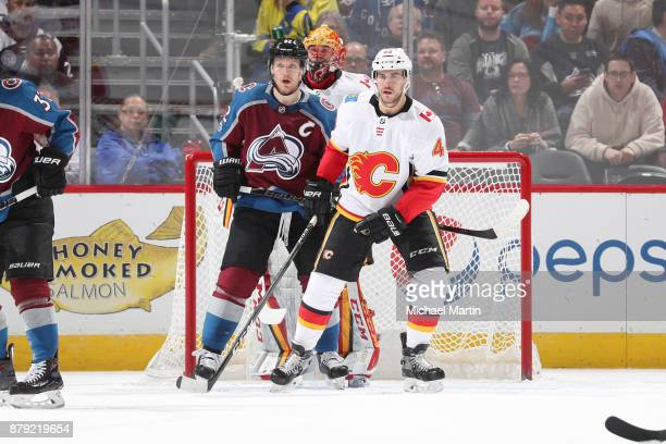 Gabriel Landeskog of the Colorado Avalanche stands next to Matt Bartkowski and goaltender David Rittich of the Calgary Flames at the Pepsi Center on...