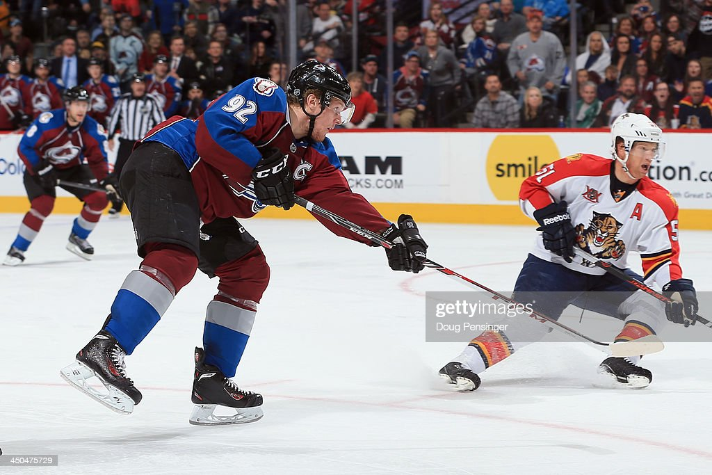 <a gi-track='captionPersonalityLinkClicked' href=/galleries/search?phrase=Gabriel+Landeskog&family=editorial&specificpeople=6590816 ng-click='$event.stopPropagation()'>Gabriel Landeskog</a> #92 of the Colorado Avalanche takes a shot against <a gi-track='captionPersonalityLinkClicked' href=/galleries/search?phrase=Brian+Campbell+-+Ice+Hockey+Player&family=editorial&specificpeople=209384 ng-click='$event.stopPropagation()'>Brian Campbell</a> #51 of the Florida Panthers at Pepsi Center on November 16, 2013 in Denver, Colorado. The Panthers defeated the Avalanche 4-1.