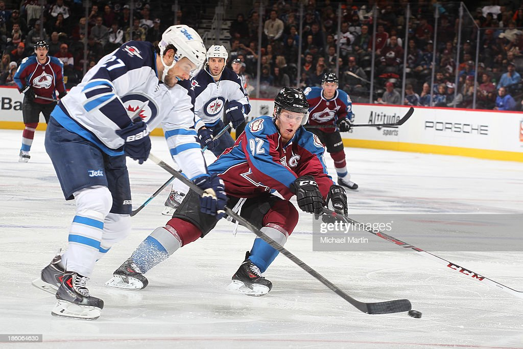 <a gi-track='captionPersonalityLinkClicked' href=/galleries/search?phrase=Gabriel+Landeskog&family=editorial&specificpeople=6590816 ng-click='$event.stopPropagation()'>Gabriel Landeskog</a> #92 of the Colorado Avalanche tries to block a pass by <a gi-track='captionPersonalityLinkClicked' href=/galleries/search?phrase=Eric+Tangradi&family=editorial&specificpeople=4361715 ng-click='$event.stopPropagation()'>Eric Tangradi</a> #27 against the Winnipeg Jets at the Pepsi Center on October 27, 2013 in Denver, Colorado. The Avalanche defeated the Jets 3-2.