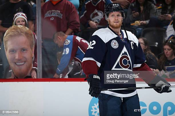 Gabriel Landeskog of the Colorado Avalanche warms up infront of a portrait of himself displayed by a fan prior to facing the St Louis Blues at Pepsi...