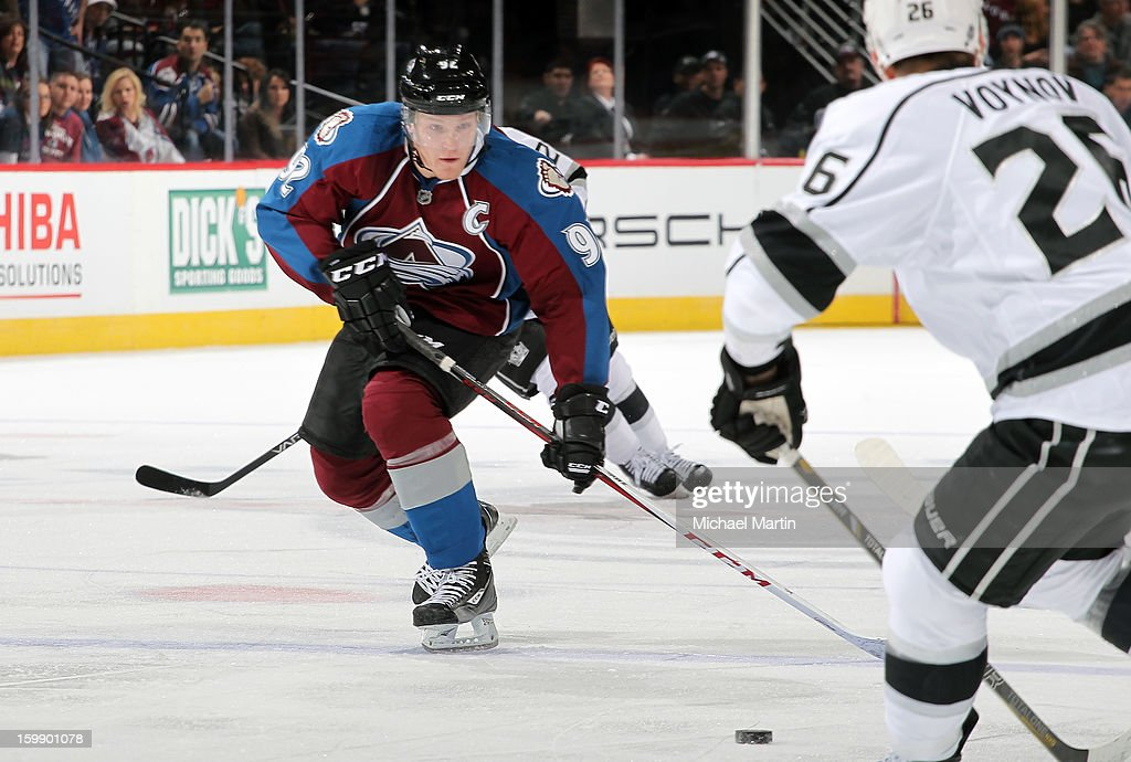 Gabriel Landeskog #92 of the Colorado Avalanche watches the puck as Slava Voynov #26 of the Los Angeles Kings skates at the Pepsi Center on January 22, 2013 in Denver, Colorado.