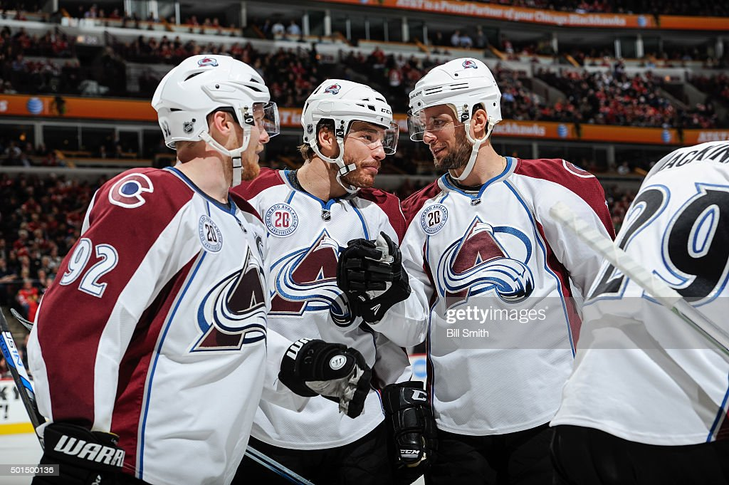 <a gi-track='captionPersonalityLinkClicked' href=/galleries/search?phrase=Gabriel+Landeskog&family=editorial&specificpeople=6590816 ng-click='$event.stopPropagation()'>Gabriel Landeskog</a> #92, <a gi-track='captionPersonalityLinkClicked' href=/galleries/search?phrase=Zach+Redmond&family=editorial&specificpeople=8234699 ng-click='$event.stopPropagation()'>Zach Redmond</a> #22 and <a gi-track='captionPersonalityLinkClicked' href=/galleries/search?phrase=Nate+Guenin&family=editorial&specificpeople=3948510 ng-click='$event.stopPropagation()'>Nate Guenin</a> #5 of the Colorado Avalanche celebrate after Matt Duchene #9 scored against the Chicago Blackhawks in the first period of the NHL game at the United Center on December 15, 2015 in Chicago, Illinois.