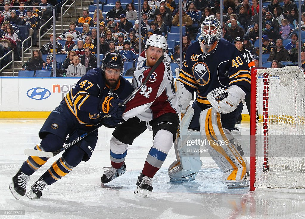 Gabriel Lendeskog #92 of the Colorado Avalanche squeezes between <a gi-track='captionPersonalityLinkClicked' href=/galleries/search?phrase=Zach+Bogosian&family=editorial&specificpeople=4195061 ng-click='$event.stopPropagation()'>Zach Bogosian</a> #47 and <a gi-track='captionPersonalityLinkClicked' href=/galleries/search?phrase=Robin+Lehner&family=editorial&specificpeople=5894610 ng-click='$event.stopPropagation()'>Robin Lehner</a> #40 of the Buffalo Sabres during an NHL game on February 14, 2016 at the First Niagara Center in Buffalo, New York.