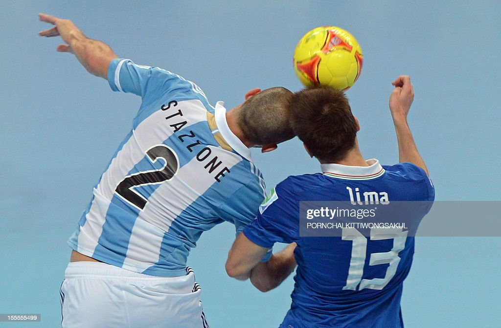 Gabriel Lima of Italy (R) battles for the ball with Damian Stazzone of Argentina (L) during their first round football match of the FIFA Futsal World Cup 2012 in Bangkok on November 5, 2012.