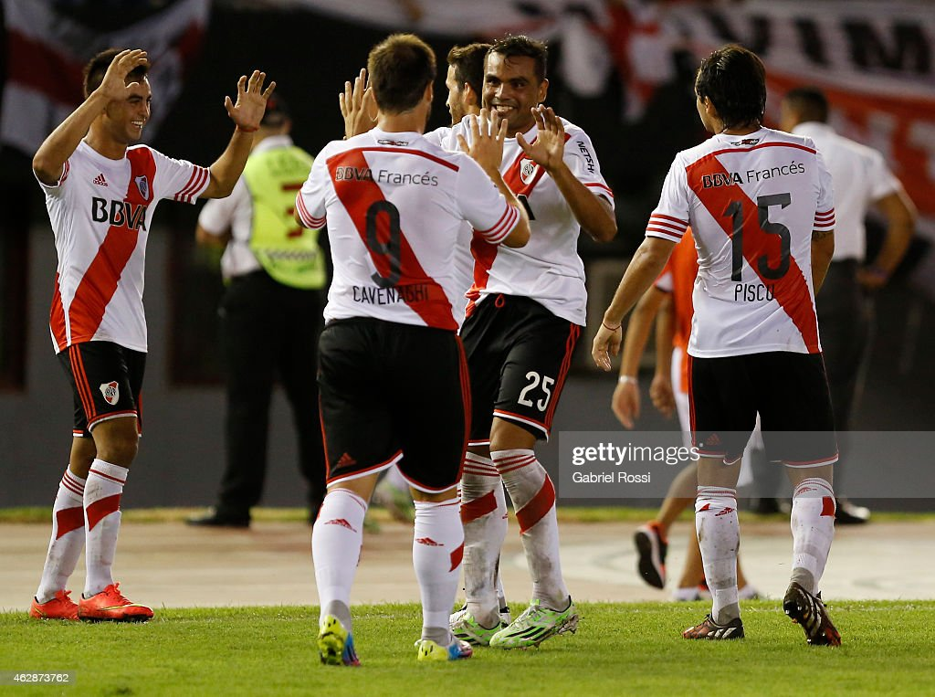 Gabriel Mercado (#25) and Fernando Cavenaghi (#9) of River Plate Plate celebrate after teammate Carlos Sanchez scored the first and winning goal of the team during a first leg match between River Plate Plate and San Lorenzo as part of Recopa Sudamericana at Monumental Antonio Vespucio Liberti Stadium on February 06, 2015 in Buenos Aires, Argentina.