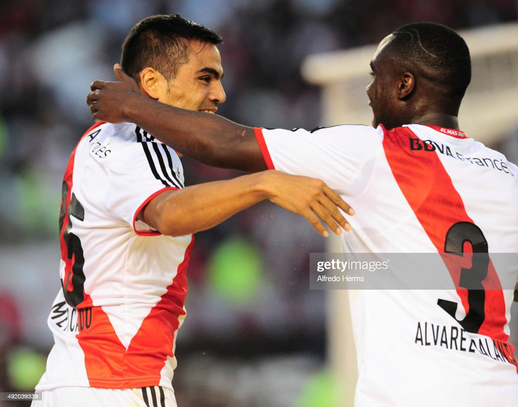 Gabriel Mercado celebrates with Eder Alvarez Balanta after scoring the third goal of his team during a match between River Plate and Quilmes as part of 19th round of Torneo Final 2014 at Monumental Antonio Vespucio Liberti Stadium on May 18, 2014 in Buenos Aires, Argentina.