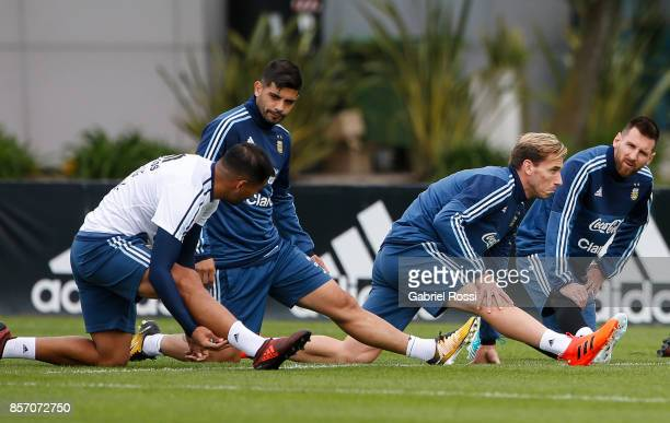 Gabriel Mercado Ever Banega Lucas Biglia Lionel Messi of Argentina and teammates stretch during a training session at Argentine Football Association...