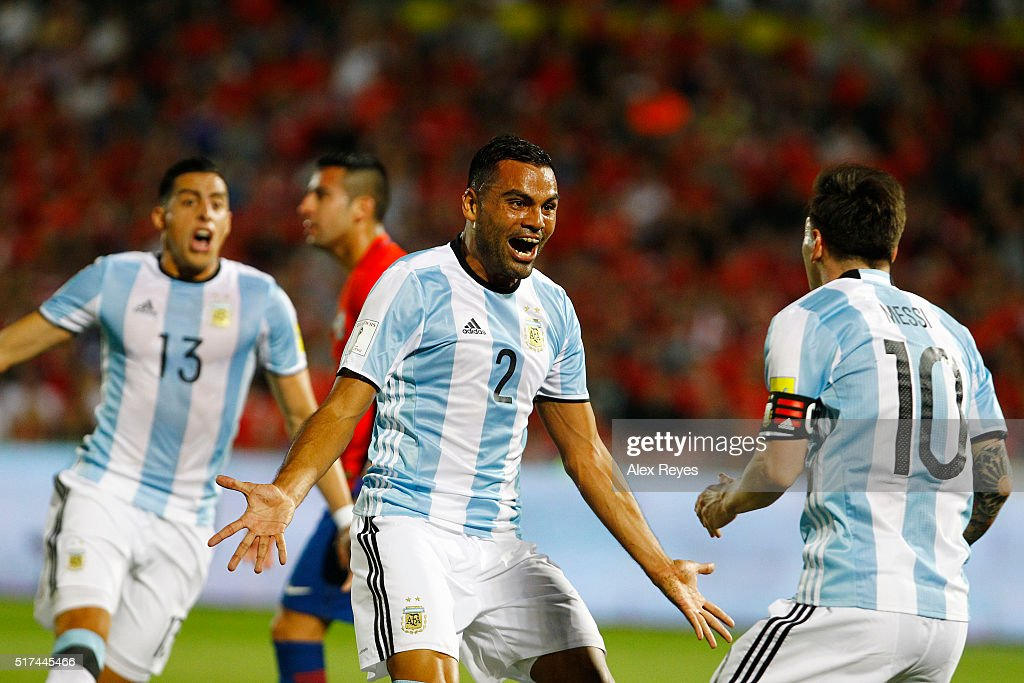 <a gi-track='captionPersonalityLinkClicked' href=/galleries/search?phrase=Gabriel+Mercado&family=editorial&specificpeople=4110696 ng-click='$event.stopPropagation()'>Gabriel Mercado</a> of Argentina celebrates after scoring the second goal of his team during a match between Chile and Argentina as part of FIFA 2018 World Cup Qualifiers at Nacional Stadium on March 24, 2016 in Santiago, Chile.