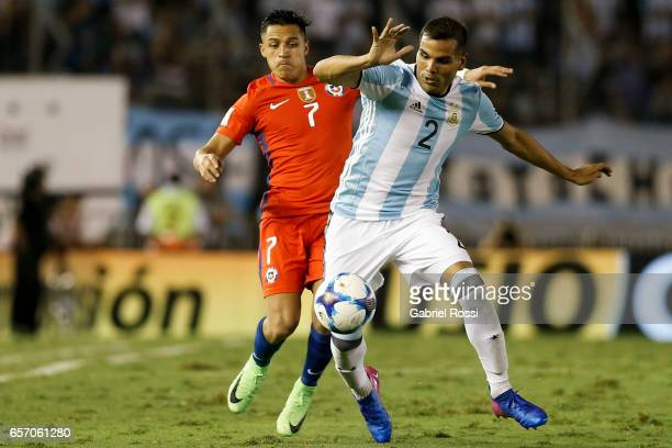 Gabriel Mercado of Argetnitna fights for the ball with Alexis Sanchez of Chile during a match between Argentina and Chile as part of FIFA 2018 World...