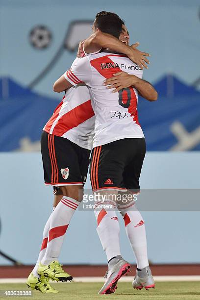 Gabriel Mercado of River Plate celebrates with his teammate Ramiro Funes Mori after scoring the second goal of his team during a match between Gamba...