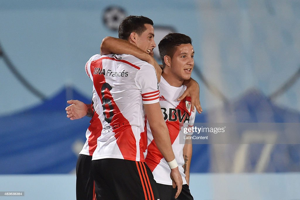 Gabriel Mercado of River Plate celebrates with his teammates Ramiro Funes Mori and Sebastian Driussi after scoring the second goal of his team during a match between Gamba Osaka and River Plate as part of Suruga Bank Championship at Osaka Expo '70 Stadium on August 11, 2015 in Suita, Japan.