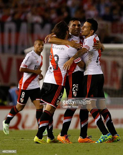 Gabriel Mercado of River Plate celebrates with teammates Leonardo Ponzio and Leonel Vangioni their team's first goal during a second leg final match...