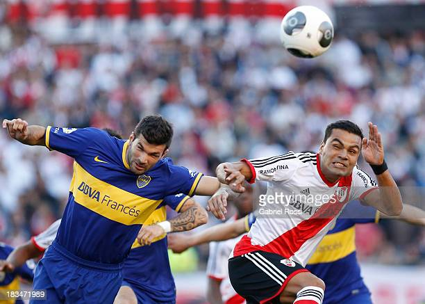 Gabriel Mercado of River Plate fights for the ball with Emmanuel Gigliotti of Boca Juniors during a match between River Plate and Boca Juniors as...